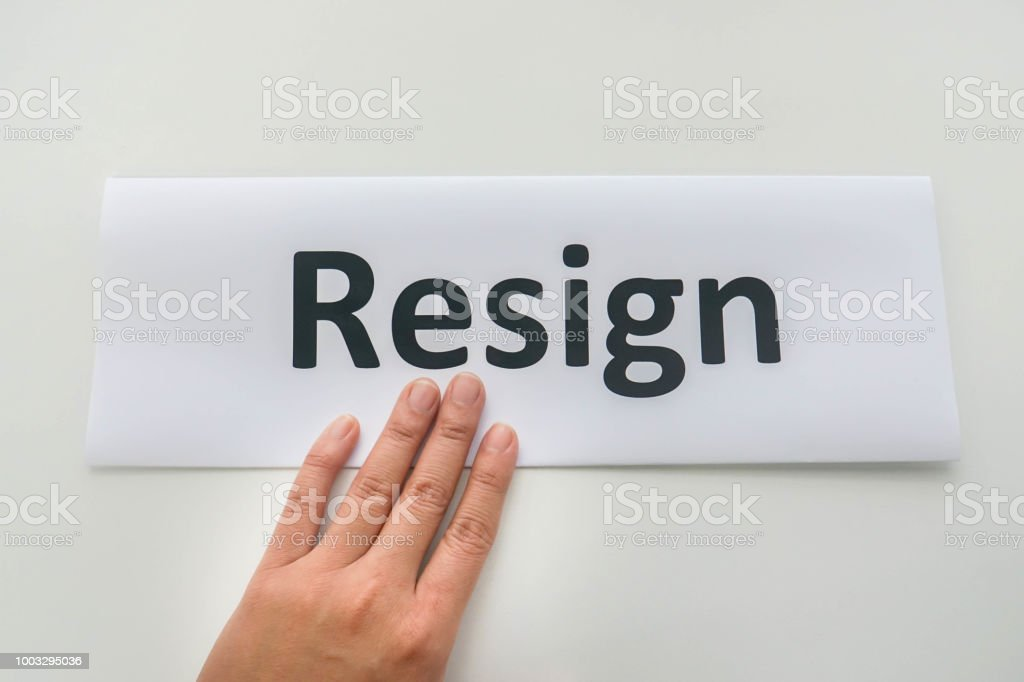 isolated businesswoman submit a resignation letter by hand stock