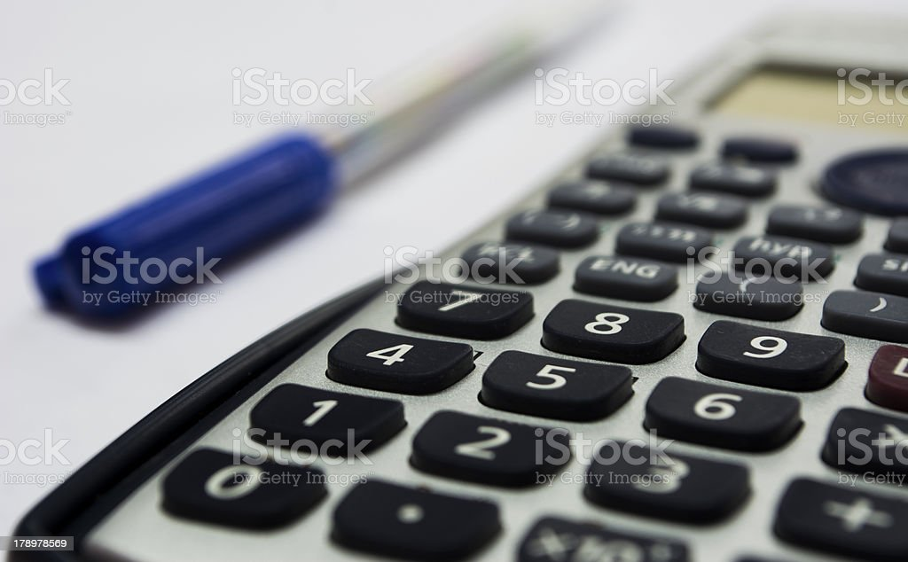 Isolated calculator and pen royalty-free stock photo