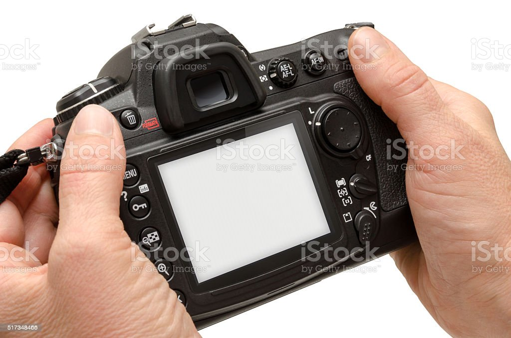 Isolated camera in hands. Isolated white screen for mockup. stock photo