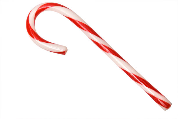 Isolated Candy Cane with clipping path Unwrapped candy cane on white with clipping path candy cane stock pictures, royalty-free photos & images