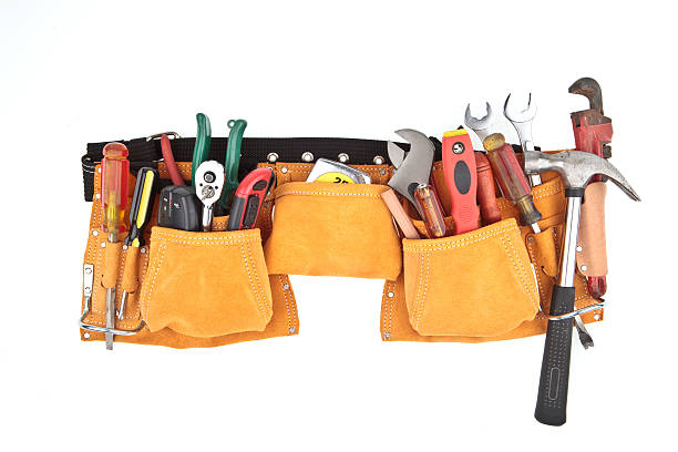 isolated carpenter work belt with tools - tool belt stock photos and pictures