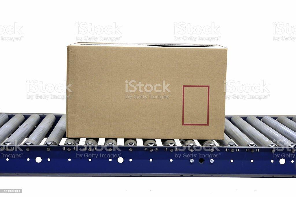 Isolated carton on conveyor rollers stock photo