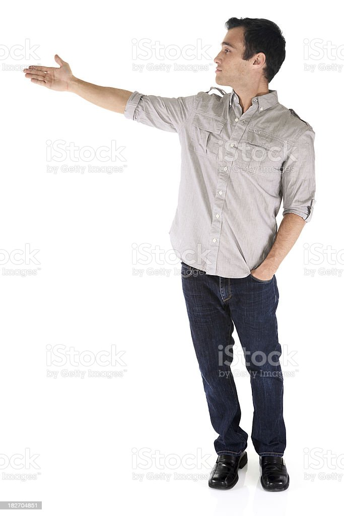 Isolated casual male presenting to the side royalty-free stock photo