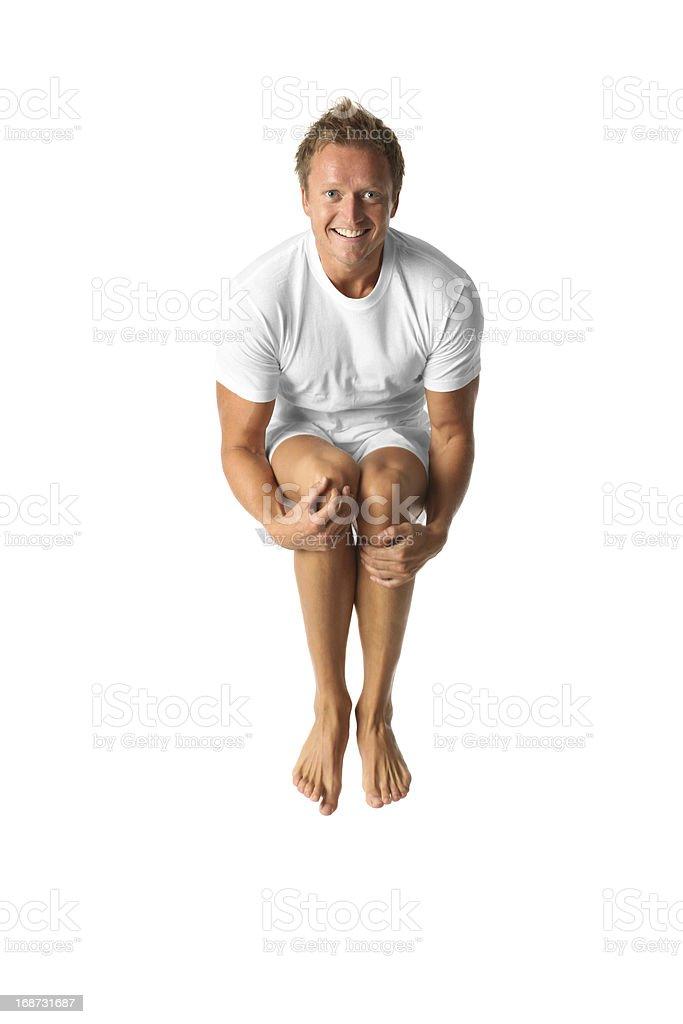 Isolierte legerer Mann springen tuck – Foto