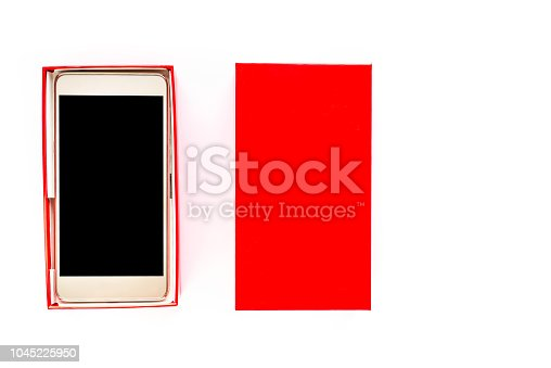 1161116588istockphoto Isolated cell phone, gift box with smartphone with black screen and touch display, elegant wireless device concept 1045225950