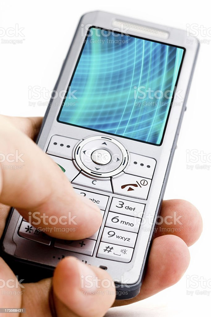 isolated cell phone in hand with blue streaks royalty-free stock photo