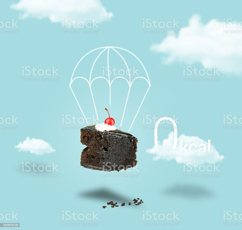 Isolated Chocolate cherry cake with parachute on blue sky background stock photo