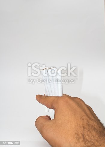 man holding isolated cigarettes in his hand