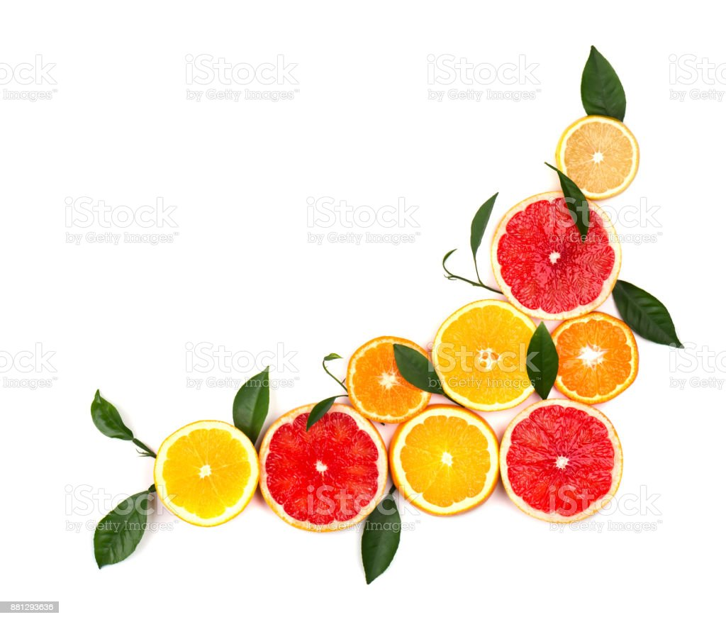 Isolated citrus fruits. Pieces of lemon, lime, pink grapefruit and orange isolated on white background, with clipping path. Top view stock photo