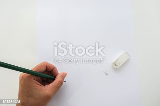 istock isolated close up people re-write on mock up paper after use rubber 828334028