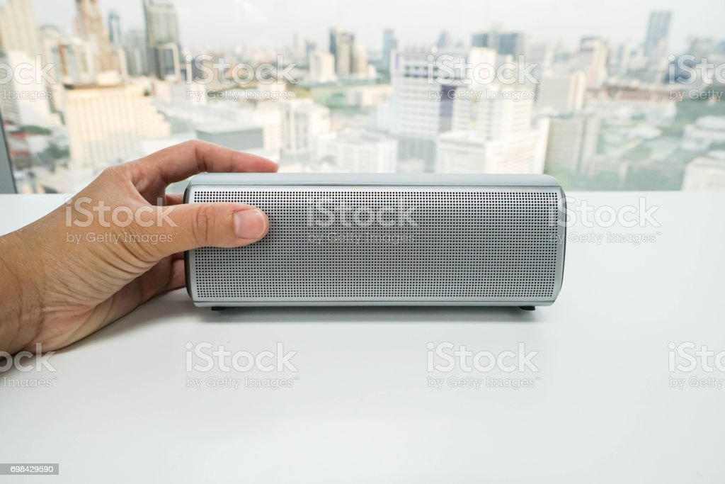 isolated close up women hand with portable bluetooth speaker for listening to music stock photo