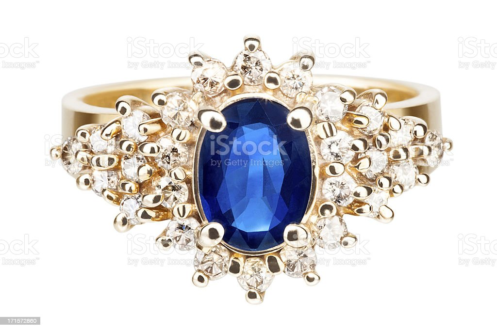 Isolated Closeup of a Gold Ring with Sapphire and Diamonds royalty-free stock photo