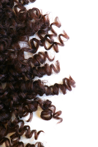 istock isolated close-up of auburn wavy and curly hair extension 1131518149