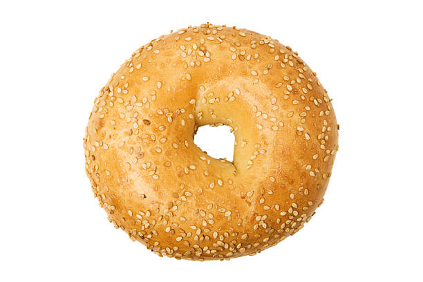 Isolated close-up of of sesame bagel on a white background stock photo