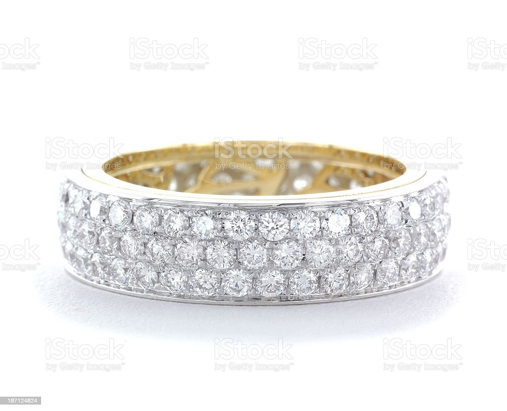 Isolated close-up of wedding ring with rows of diamonds royalty-free stock photo