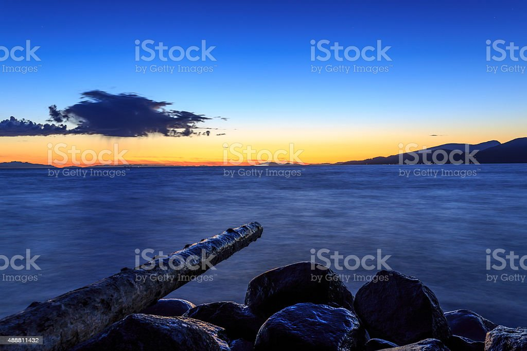 isolated clouds after sunset stock photo