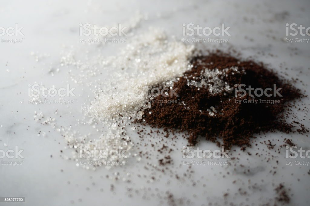 Isolated coffee and sugar on white marble stock photo