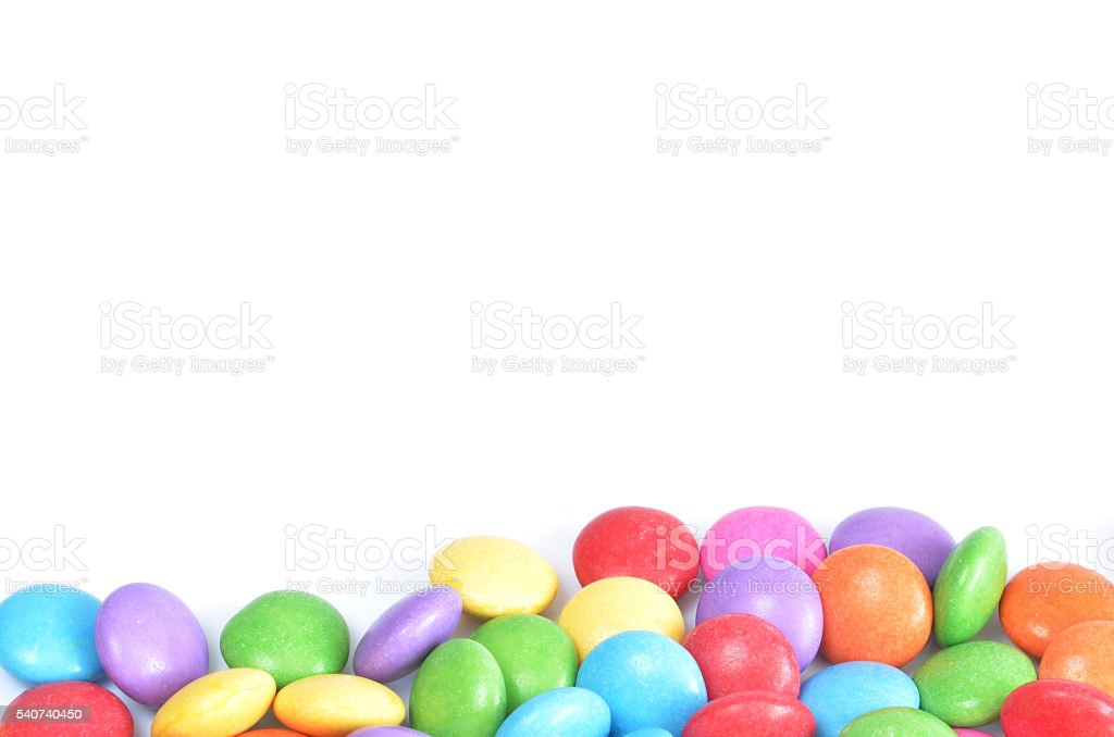 Isolated colored smarties on white background stock photo