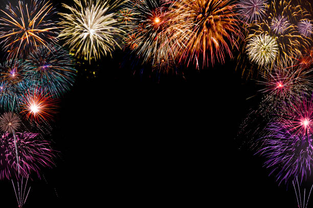 isolated colourful fireworks background with space in the middle isolated new year fireworks on black background with copy space in the middle day 4 stock pictures, royalty-free photos & images