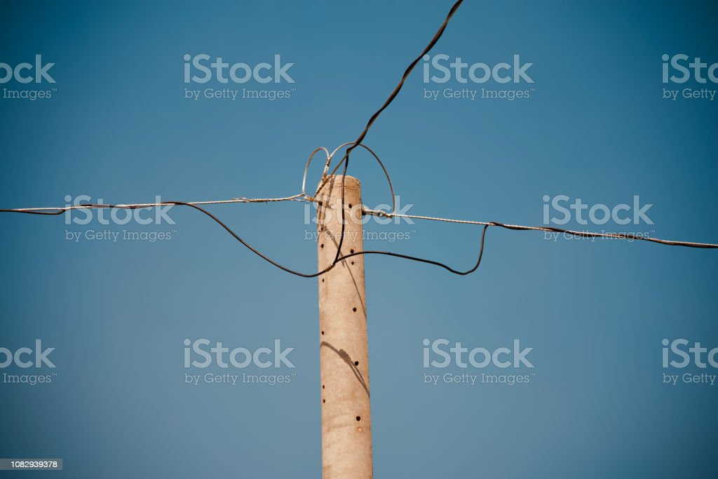 Isolated concrete electric pole unique photo stock photo
