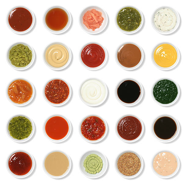 "Isolated Condiment Collection Assortment ""Twenty five everyday condiments isolated on white.  From top to bottom, left to right, they are: barbecue sauce, malt vinegar, pickled ginger (gari shoga), tomatillo salsa (salsa verde), tartar sauce, chopped green chile, Dijon mustard, ketchup, satay sauce, yellow mustard, mango chutney, garlic chile sauce, mayonnaise, soy sauce, mint sauce, sweet pickle relish, hot wing sauce, salsa, sriracha, Worcestershire sauce, sweet and sour, tahini, wasabi, whole grain mustard, 1000 island."" salsa sauce stock pictures, royalty-free photos & images"