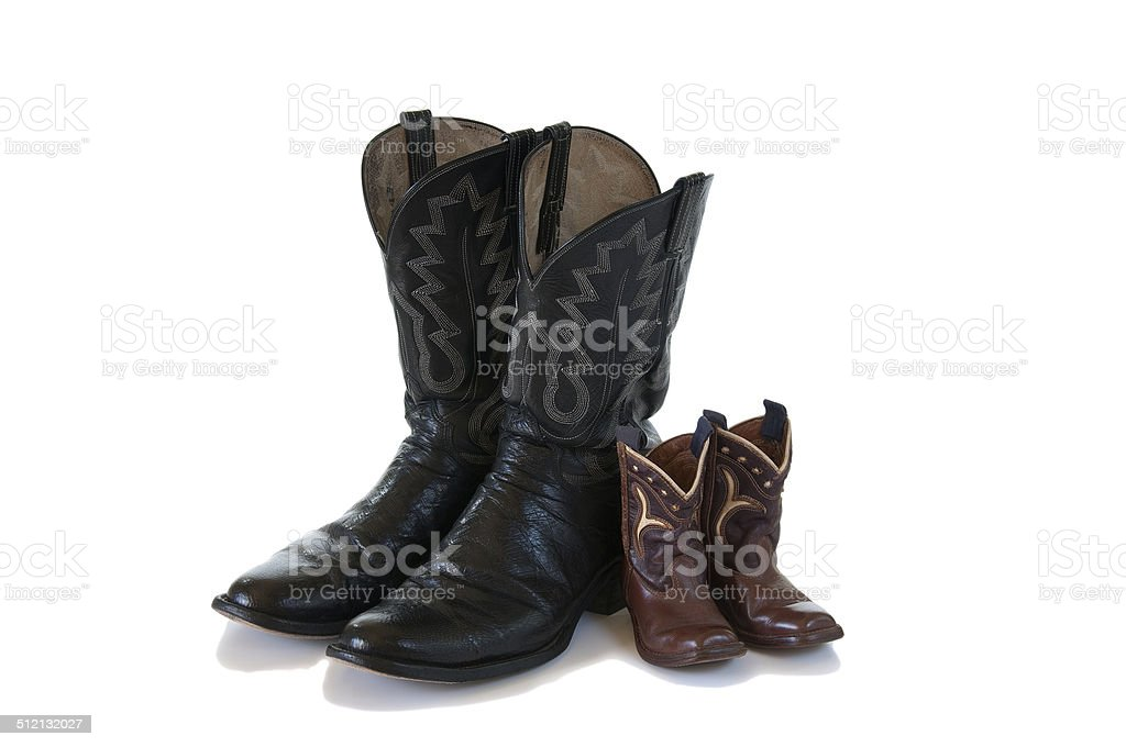 Isolated cowboys boots of father and son stock photo