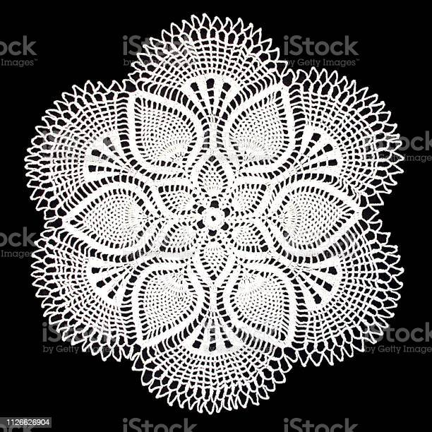 Isolated crocheted white doily with a pattern of cones on a black picture id1126626904?b=1&k=6&m=1126626904&s=612x612&h=gcczjyzol7pck8hphd7m0eo6j8p9zpnq2kdo6do x c=