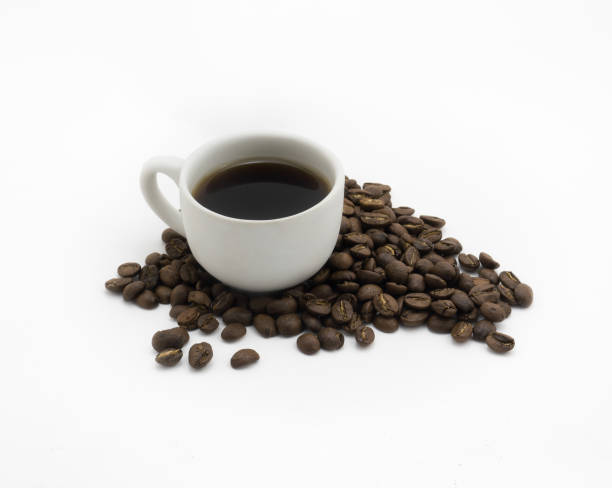 Isolated Cup of coffee and dark roasted coffee beans stock photo