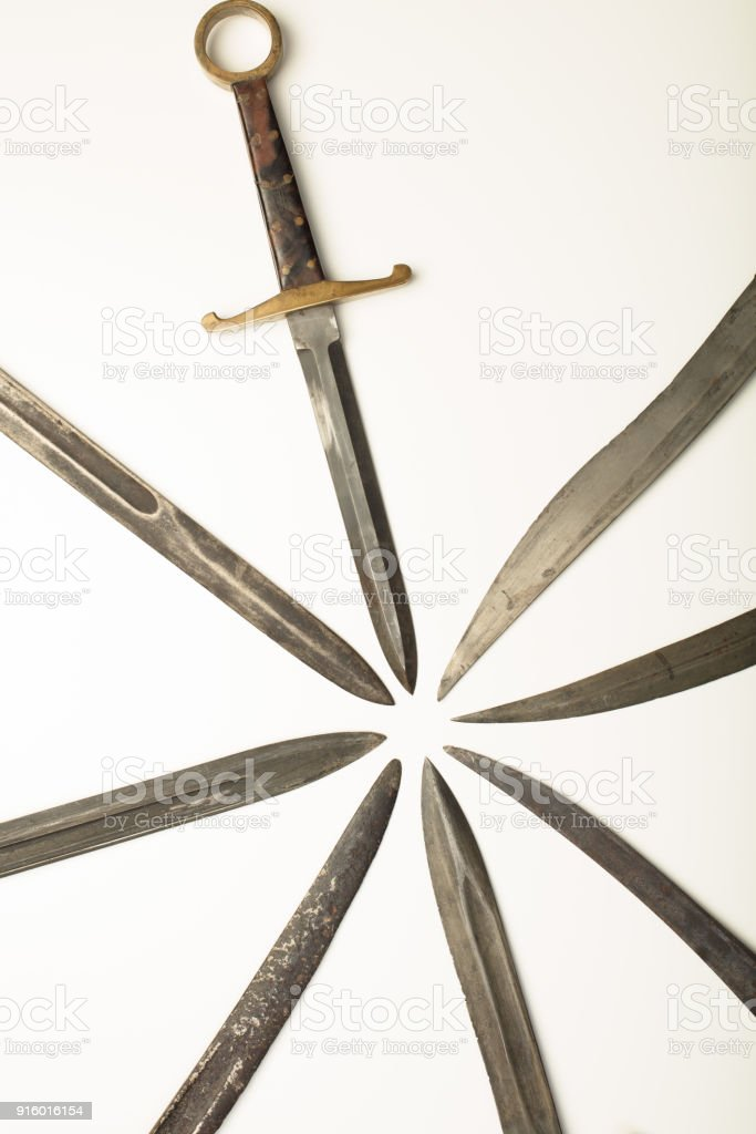 Isolated dagger with assorted blades of weapons stock photo
