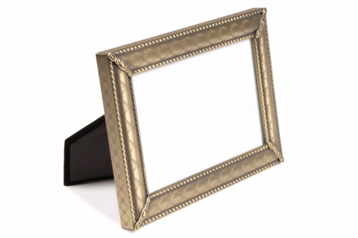 Isolated photograph of an empty decorative 4x6 pewter picture frame. Includes clipping path for easily inserting an image inside the frame.