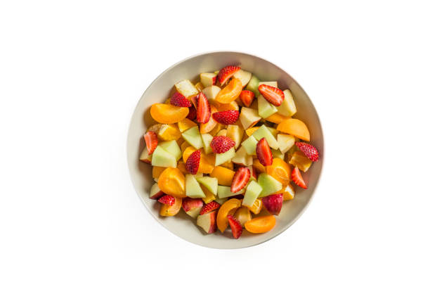 Isolated Delicious Fruit Salad Delicious Fresh Fruit Salad on Table fruit salad stock pictures, royalty-free photos & images