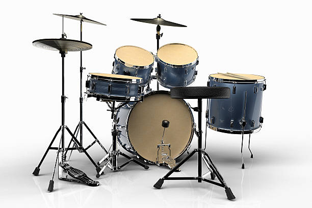 Isolated Drums Drums against a white background drum kit stock pictures, royalty-free photos & images