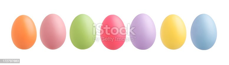 Bright colored Easter eggs in a row.