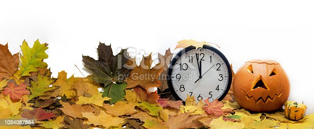 607492948 istock photo Isolated electronic wall clock. Autumn abstraction. Fall back time 1054087884