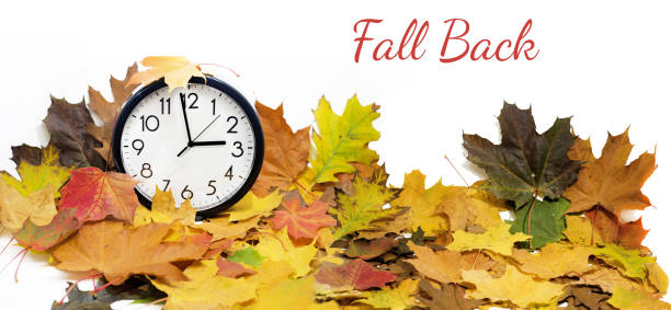 Isolated electronic wall clock. Autumn abstraction. Isolated electronic wall clock. Autumn abstraction. Fall back time. time zone stock pictures, royalty-free photos & images