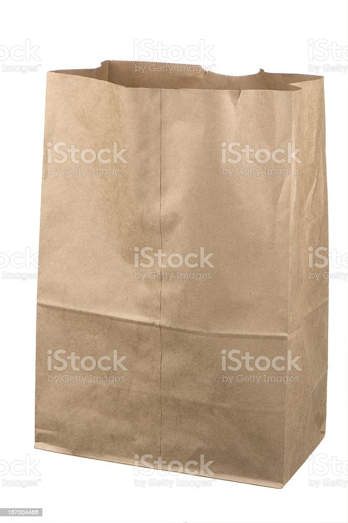 Isolated empty brown grocery bag on white background stock photo