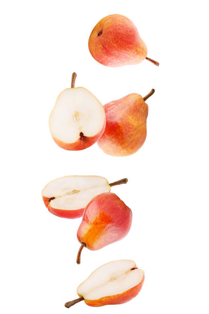 Isolated falling fruits. Falling sweet pear fruits isolated on white background with clipping path as package design element stock photo