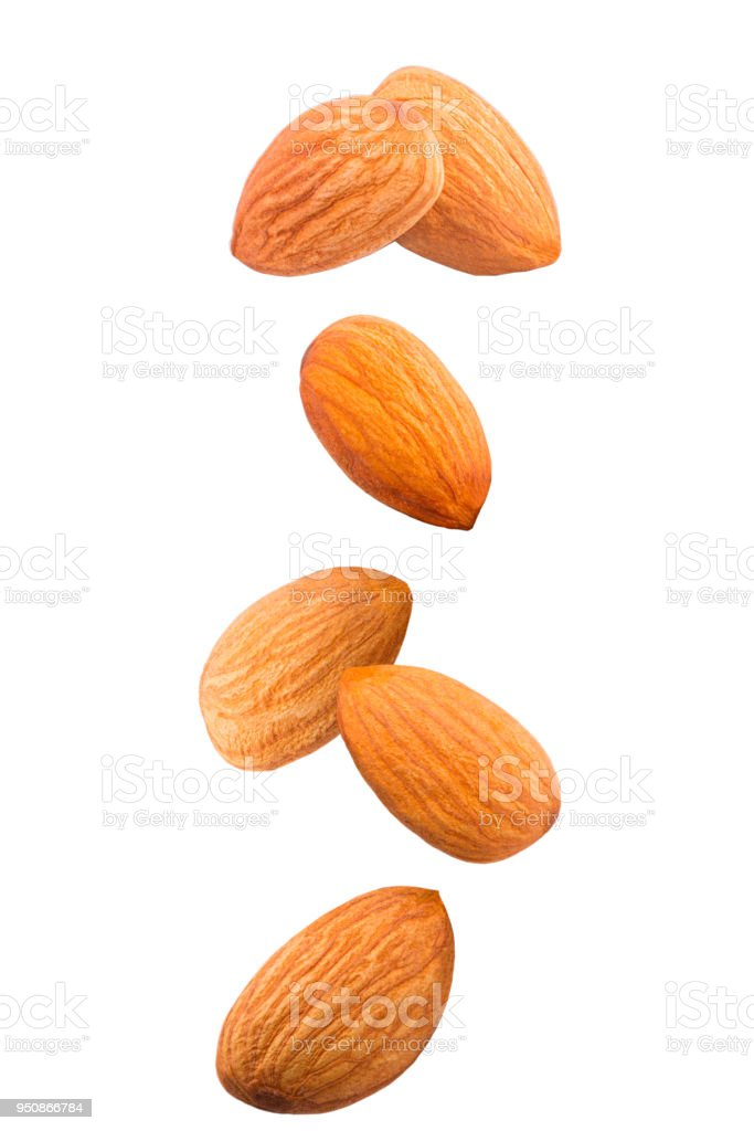 Isolated falling nuts. Falling almonds isolated on white background with clipping path as package design element. - foto stock