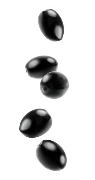 Isolated falling olives stock photo