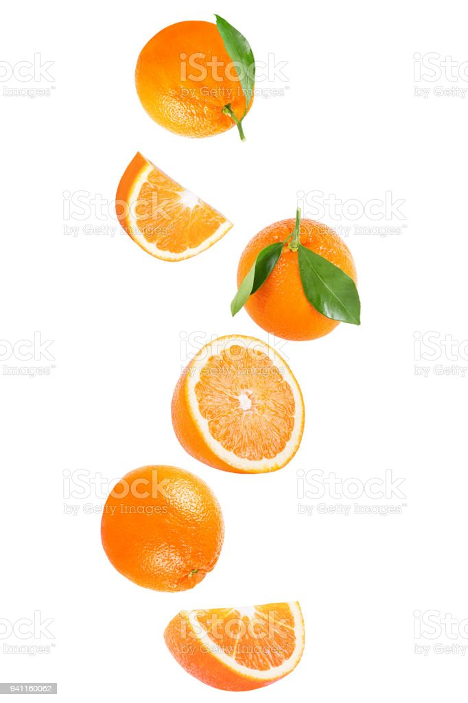 Isolated falling orange fruit on white background with clipping path - foto stock