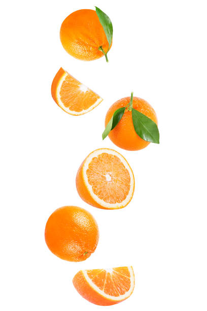 Isolated falling orange fruit on white background with clipping path stock photo