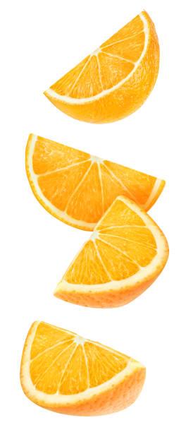 isolierte fallenden orange stücke - 25 cent stück stock-fotos und bilder