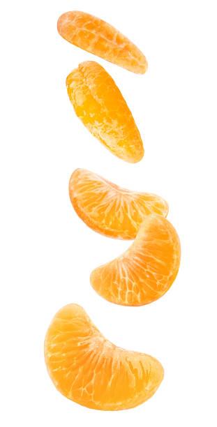 Isolated falling orange segments stock photo