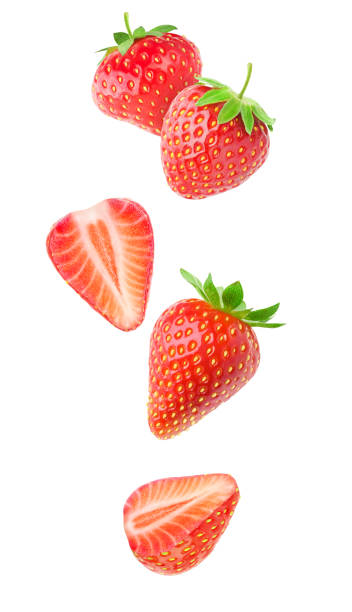 Isolated falling strawberries stock photo