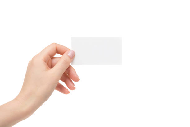 isolated female hand holds white card on a white background. - gripping stock photos and pictures