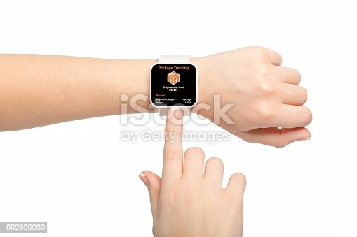 istock Isolated female hand with white smartwatch app package tracking 662936080