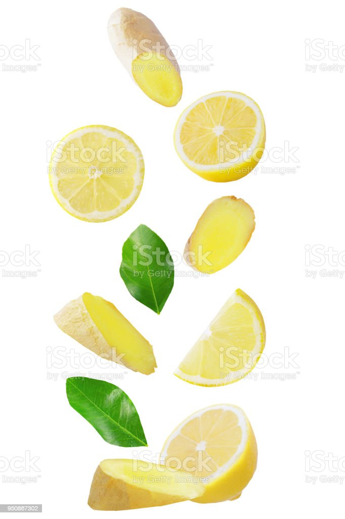 Isolated flying fruits. Falling lemon and ginger isolated on white background with clipping path as package design element and advertising - foto stock