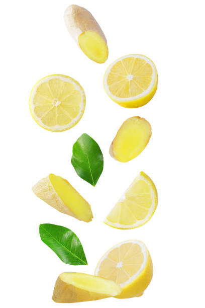 Isolated flying fruits. Falling lemon and ginger isolated on white background with clipping path as package design element and advertising stock photo