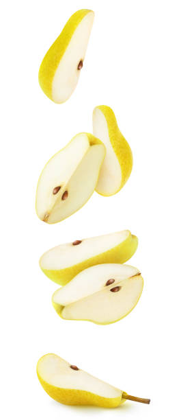 Isolated flying pieces of yellow pear stock photo