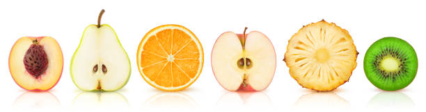 Isolated fruit halves in a row stock photo